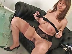 Masturbating Mature Redhead With Vibrator